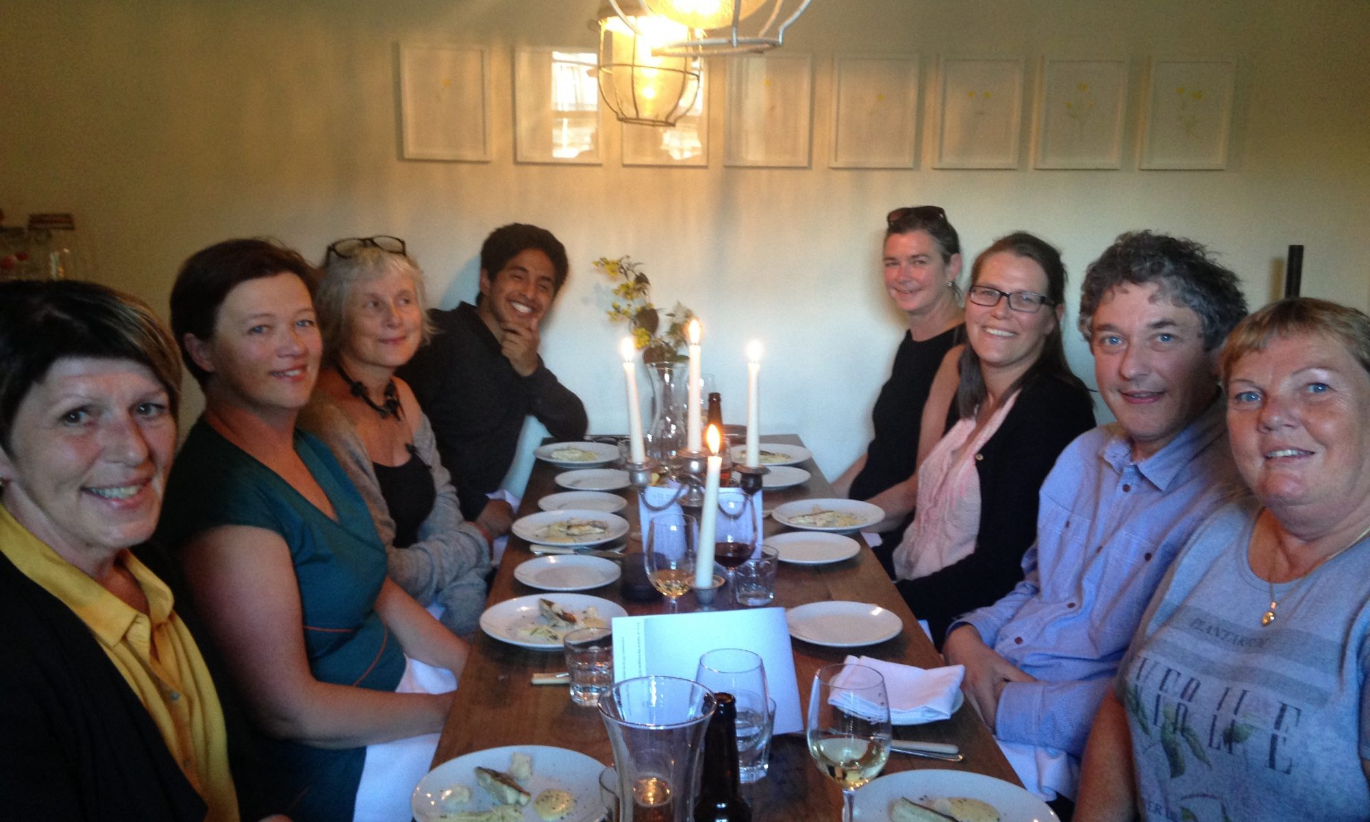Tour guide Mark Fisher enjoys a meal with a Norwegian delegation